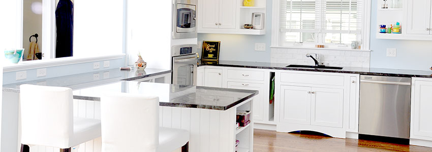 A McCarthy kitchen in white, granite, and stainless steel.